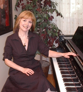 Debbie At Piano in studio